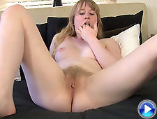 Satine Spark pleasures her pale pussy