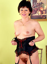 Hairy pussied Eva in sexy black lingerie