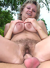 Hot older MILF with wildly bushy cunt takes a cock pounding