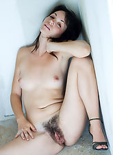 Blue eyed girl with powdery skin and a contrasting big lovely bush