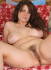 Tori strips to reavela big natural tits and a full bush