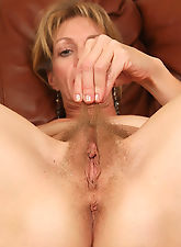 44 year old Marlee displaying her very hairy beaver