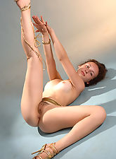 New model Neli gets comfortable letting us know how flexible she really is