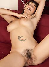 Smoking hot Angelina Dee is kinky on the sofa