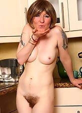 Hairy Samantha gets naked in the kitchen