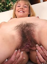 hairy girls, Charlotte spreads her hairy pussy on the couch
