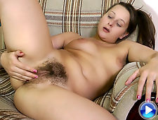 Vera bares her hairy pussy in a recliner